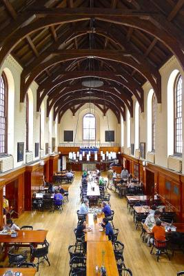 A dining hall filled with people eating.